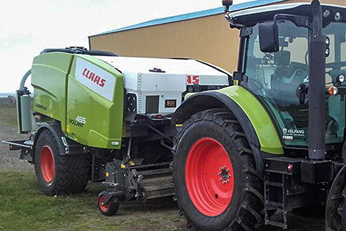 Claas baler with Selmech's 250 litre digital additve applicator fitted.