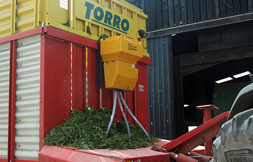 Triple outlet Powder Master mounted on Forage Wagon